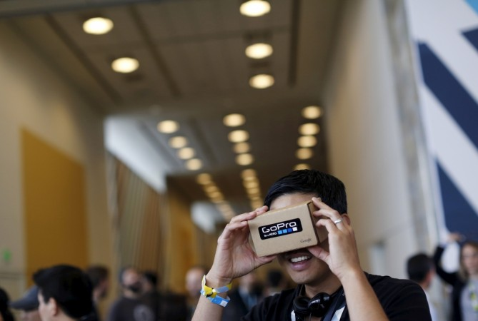 "A conference attendee looks through ""Cardboard,"" a viewer"