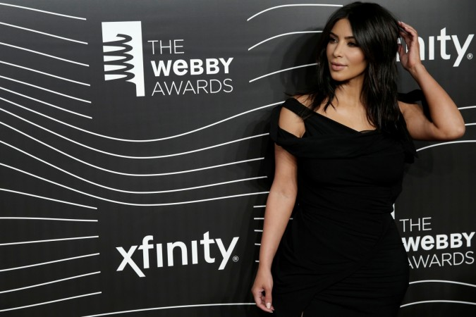 Kim Kardashian West poses as she arrives for the 20th Annual Webby Awards in Manhattan