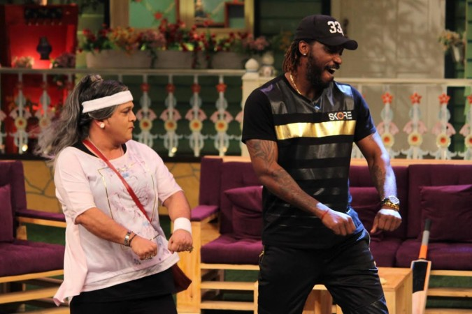 "Cricketer Chris Gayle in ""Jhalak Dikhhla Jaa 9""? Pictured: Chris Gayle shaking legs with Ali Asgar on ""The Kapil Sharma Show."""