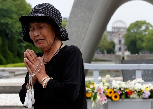 Woman prays before Hiroshima memorial