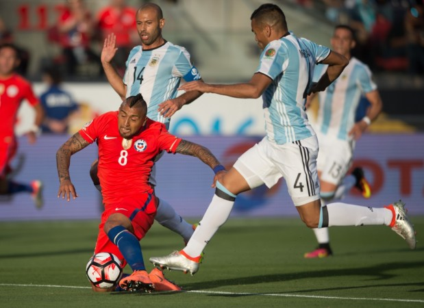 Chile's Arturo Vidal (down) vies for the ball during the Copa America Centenario Group D match between Argentina and Chile at the Levi's Stadium in Santa Clara, California, the United States, June 6, 2016. Argentina won by 2-1.