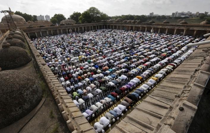 Why do Muslims sacrifice animals during Eid al Adha?