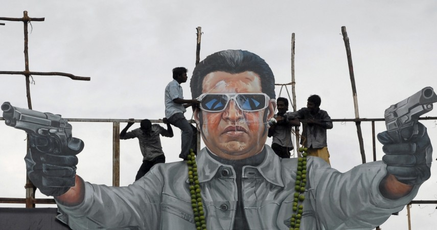 Fans of south Indian film star Rajinikanth pour milk as an offering over his cut-out