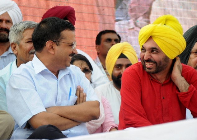 Delhi Chief Minister and AAP leader Arvind Kejriwal and party MP Bhagwant Mann during a programme organised to release AAP's manifesto for upcoming Punjab elections in Amritsar on July 3, 2016