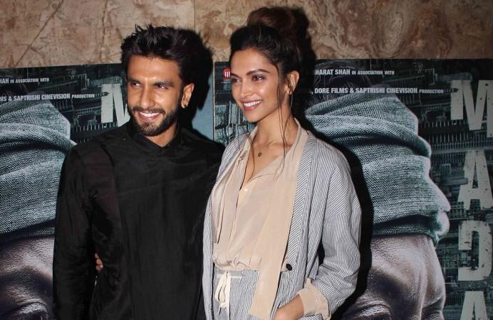 """Deepika Padukone kiss Ranveer Singh in public. Pictured: Deepika Padukone and Ranveer Singh at the screening of Irrfan Khan's """"Madaari."""""""