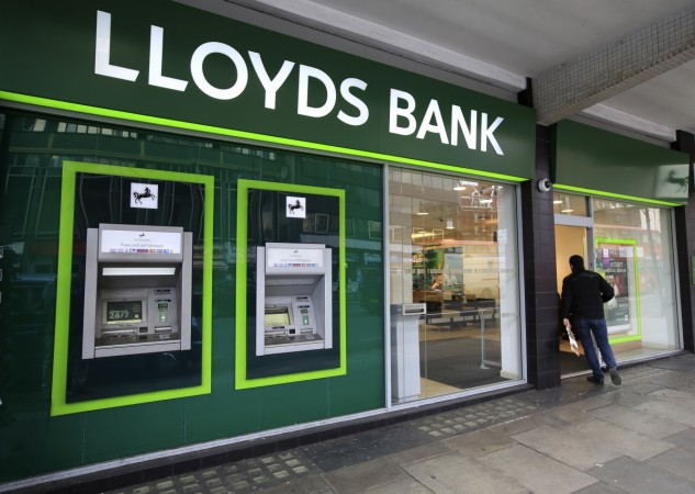 lloyds banking group job cut net profit branches shut down
