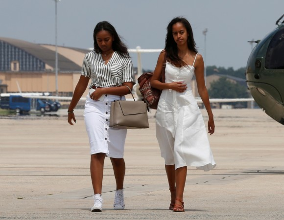 U.S. President Barack Obama's daughters Sasha (L) and Malia arrive with their parents to board Air Force One for travel to Massachusetts for their annual vacation at Martha's Vineyard, from Joint Base Andrews, Maryland, U.S. Aug. 6, 2016