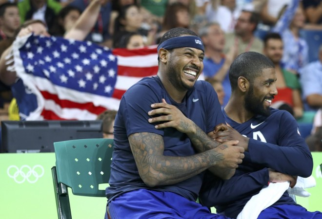 Carmelo Anthony of the USA and team mate Kyrie Irving celebrate.