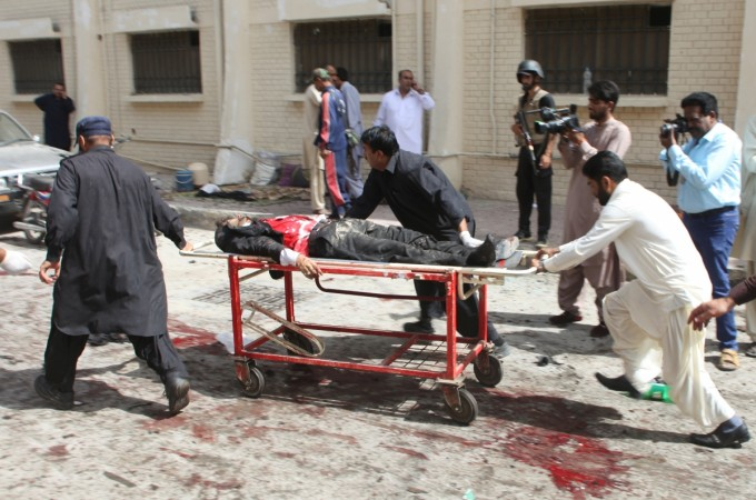 First responders and volunteers transport the injured and dead away from the scene of a bomb blast outside a hospital in Quetta, Pakistan, on Aug. 8, 2016.