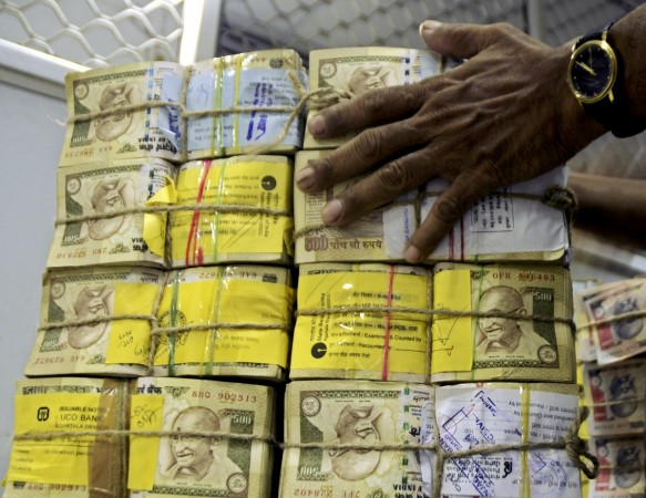aap mla raid income tax cash seizure recovery aap bjp clash recovery unaccounted wealth black money