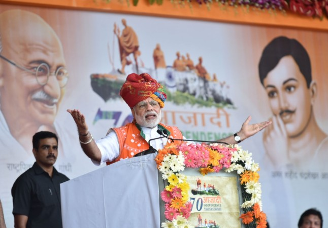 India's Prime Minister Narendra Modi addresses a public meeting to mark the launch of 70th Freedom Year Celebrations, in Bhabra village, Alirajpur district, Madhya Pradesh, on Aug. 9, 2016.