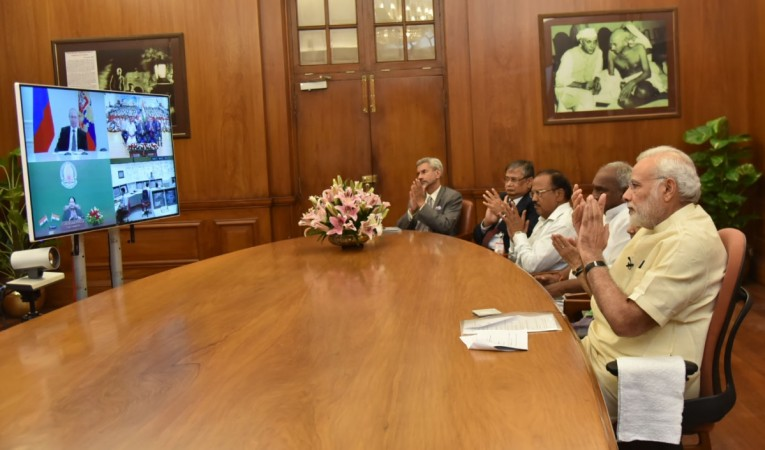 Prime Minister Narendra Modi attends the dedication Kudankulam Nuclear Power Plant Unit-1 to the nation with Russian President Vladimir Putin and Tamil Nadu Chief Minister J Jayalalitha, through video conferencing, in New Delhi on Aug. 10, 2016.