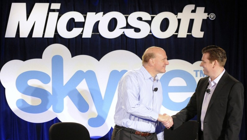Microsoft Chief Executive Officer (CEO) Steve Ballmer (L) and Skype CEO Tony Bates