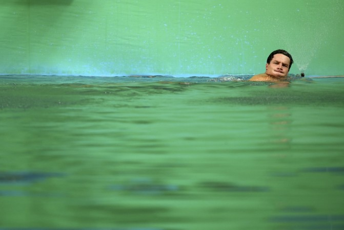 Patrick Hausding (GER) of Germany swims in the green coloured water of the diving pool at the Maria Lenk Aquatics Centre.