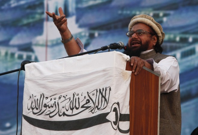 Hafiz Saeed head of the Jamaat-ud Dawa organisation and founder of Lashkar-e Taiba, gestures while addressing his supporters in Karachi Jan. 25 2015