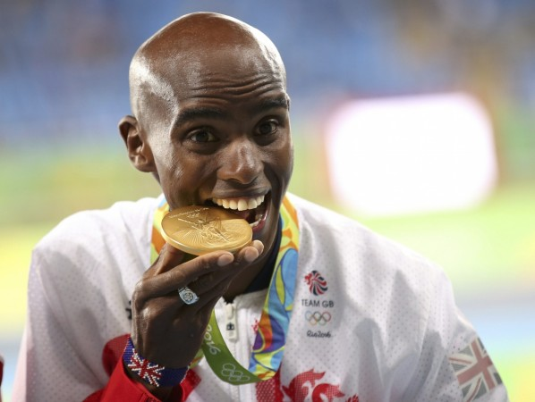 There's a history and a mystery behind Olympians biting their medals