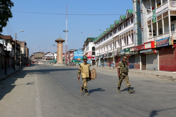 Soldiers deployed on Srinagar road as curfew continues for the 36th consecutive day in Kashmir on Aug. 13, 2016.