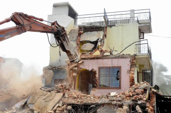 demolition bbmp bangalore bengaluru tech parks malls ramesh officials bda bbmp bmtf arrest congress bjp jds storm water drains swds floods rains