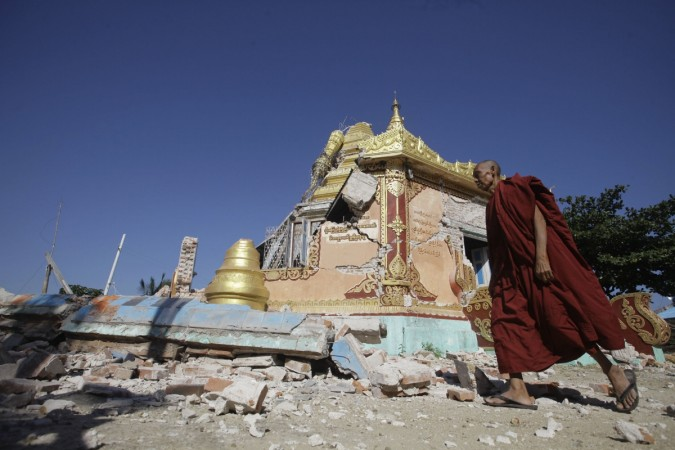 A Buddhist monk walks in front of damaged pagoda in Thabeik Kyin township Nov. 12, 2012. Aftershocks rattled central Myanmar after an earthquake that killed at least 11 people, with that toll likely to rise on Monday as several workers were missing after