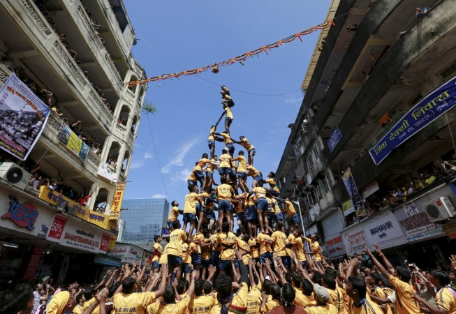Devotees try to form a human pyramid to break a clay pot containing curd during celebrations to mark the Hindu festival of Janmashtami in Mumbai, India, Sept. 6, 2015.