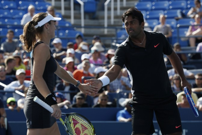 Paes, Bopanna out of men's doubles; Sania wins in mixed