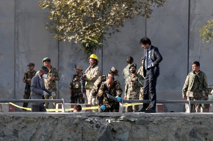 Afghan security forces inspect at the site of a suicide attack in Kabul, Afghanistan Sept. 5, 2016.