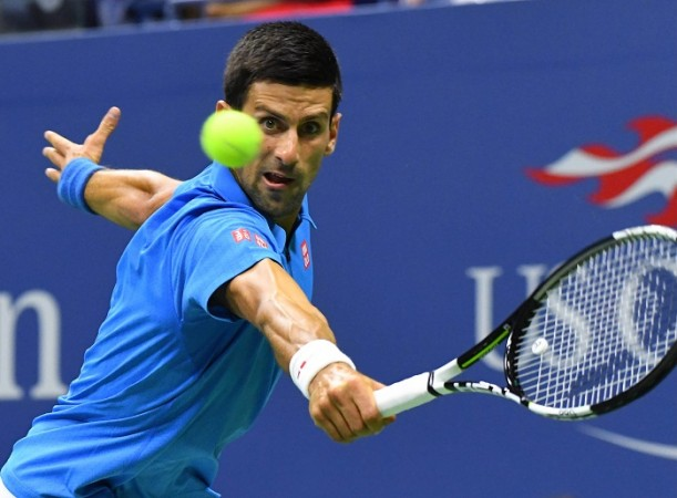 Djokovic wins at Open despite elbow complaint