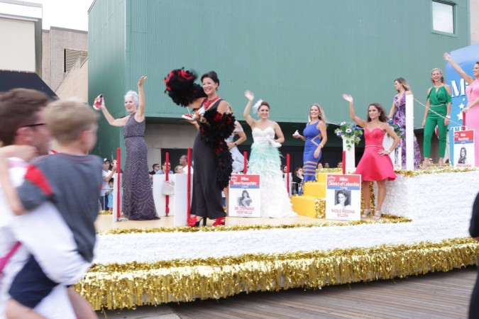 Parade float featuring Miss America winners from the past years