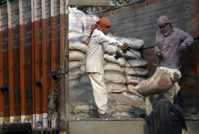 cement consumption india construction shares acc ambuja jindal jsw ultratech analyst demand supply monsoon rural homes pay commission