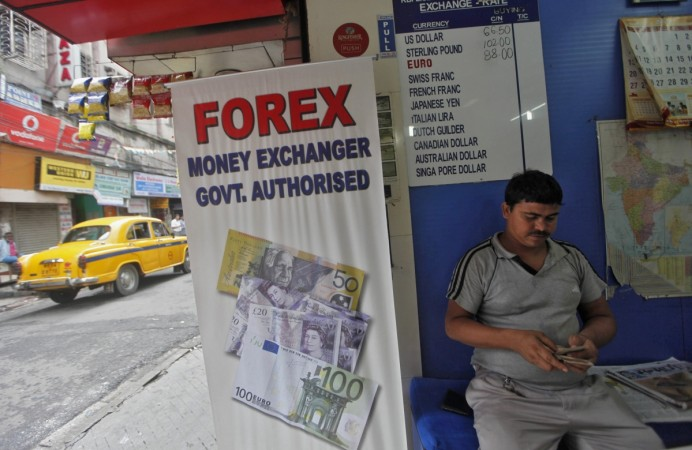 rupee devaluation dbs bank analyst rao radhika exports import rbi efforts stabilise fcnr fieo reports media competition weak global economy