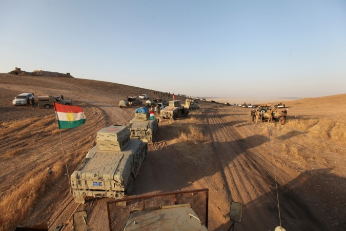 Military vehicles of the Kurdish Peshmerga forces are seen on the southeast of Mosul, Iraq, Aug. 14, 2016.