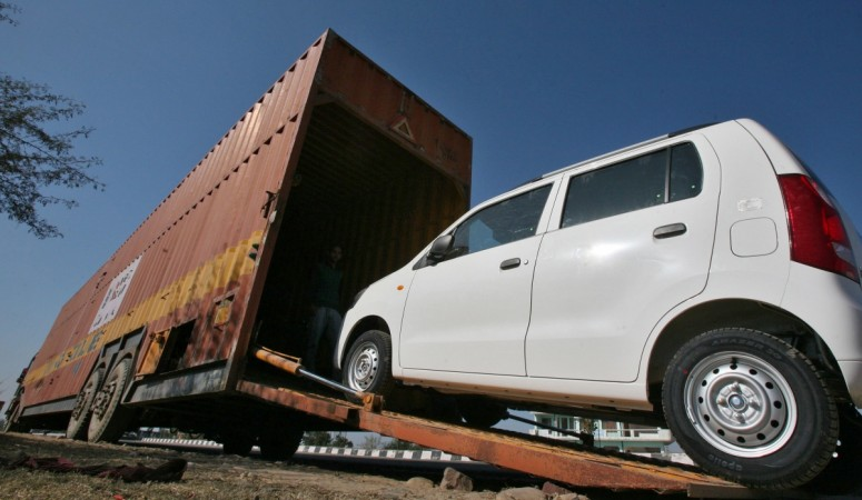 Maruti Suzuki exports touch 15 lakh marks. Pictured: A worker unloads an A-Star car from a container at a Maruti Suzuki stockyard .