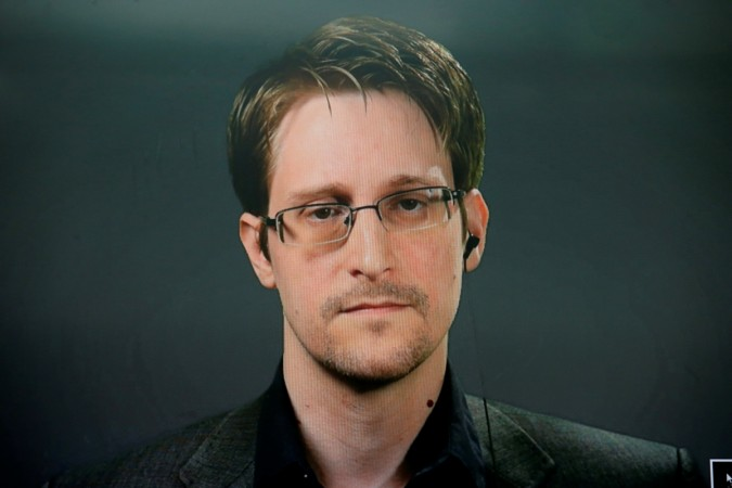 Edward Snowden speaks via video link during a news conference