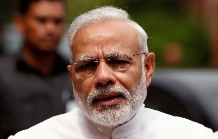 Prime Minister Narendra Modi speaks to the media inside the parliament premises
