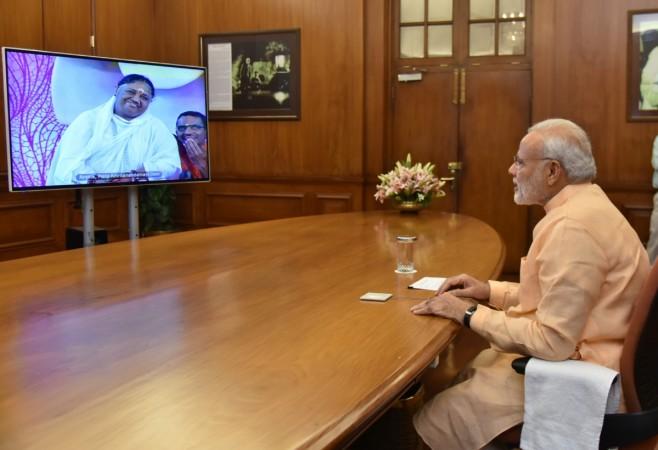 Prime Minister Narendra Modi interacts with Mata Amritanandamayi