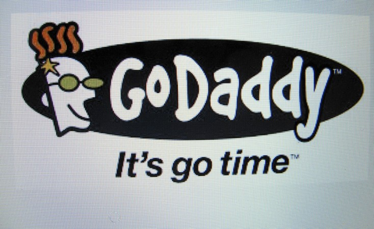 The GoDaddy inc. logo is shown on a computer screen