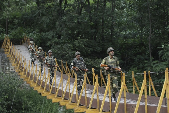 File photo of Indian Border Security Force (BSF) soldiers patrol over a footbridge near the Line of Control (LoC), a ceasefire line dividing Kashmir between India and Pakistan, at Sabjiyan sector of Poonch district.