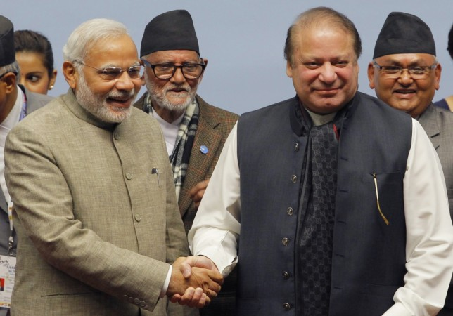 India's PM Modi shakes hands and his Pakistani counterpart Nawaz Sharif at the 18th South Asian Association for Regional Cooperation (SAARC) summit.