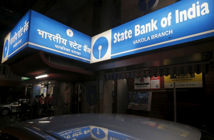 People line up outside an ATM at a State Bank of India branch