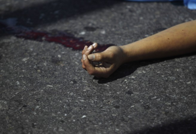 10 of family hacked to death
