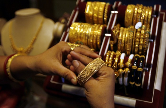 gold silver prices buying demand weak titan pc jeweller gitanjali gems global cues dhanteras 2016 auspicious hindus festival diwali bse nse