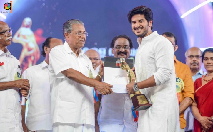 Dulquer Salmaan receives Kerala State Film Best Actor Award from Pinarayi Vijayan
