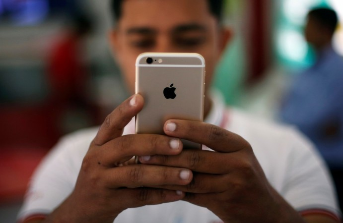 apple india sales net profit falls 15 years tim cook ceo owner smartphones china 45.5 million units us narendra modi samsung conference call investors