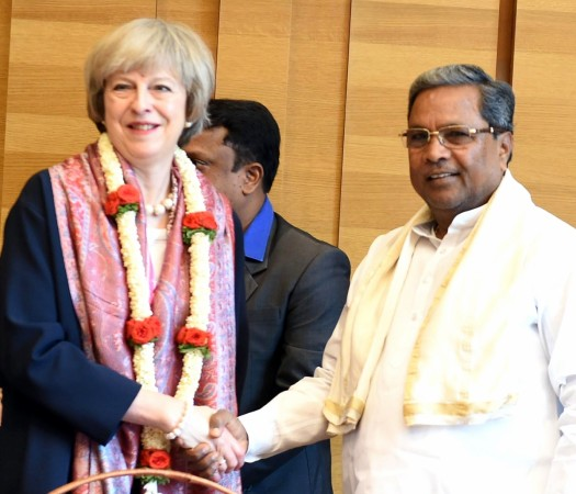 Prime Minister Theresa May AND  Karnataka Chief Minister Siddaramaiah