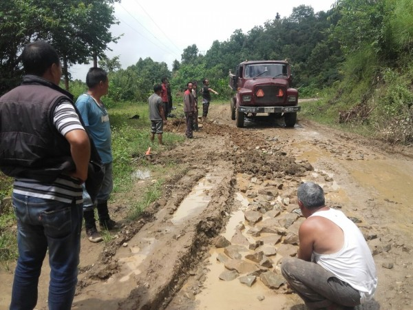Villagers in Manipur repair road