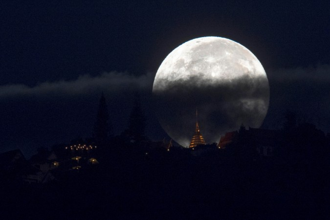 The supermoon is partly covered by clouds