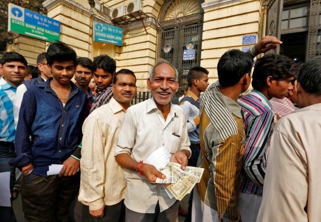 demonetisation, remonetisation, rbi update, digital india, cashless economy, modi, niti aayog, bibek debroy
