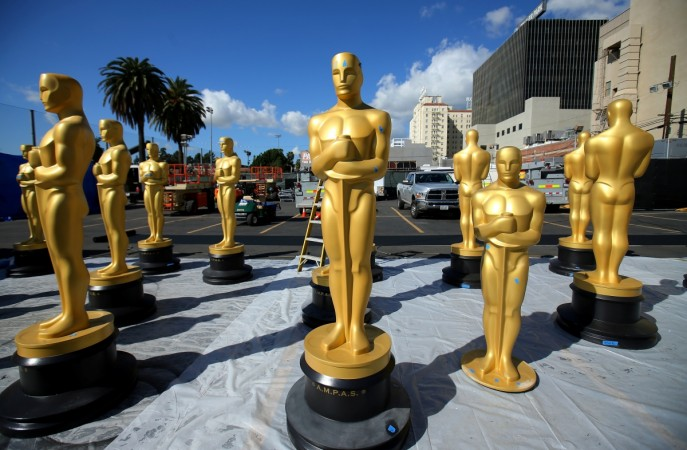 Peele, Del Toro win at an Oscars full of change