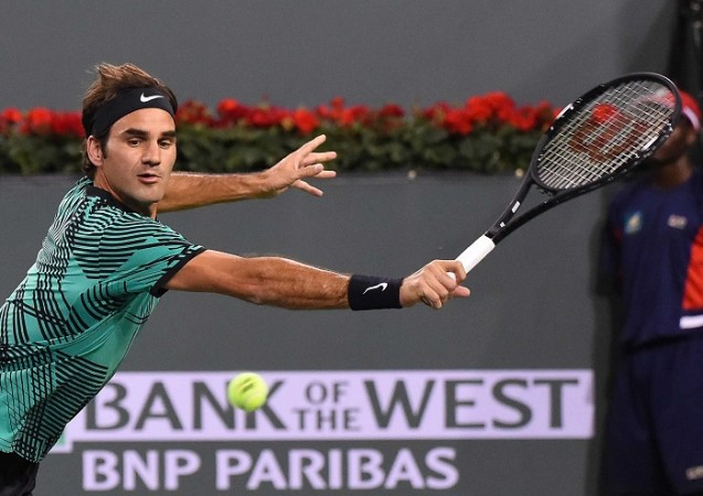 Federer advances to BNP semifinals after opponent withdraws due to illness