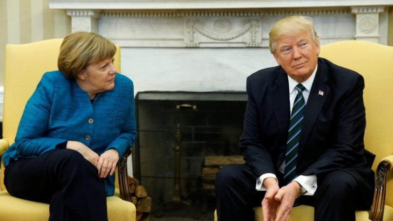 Trump appears to refuse handshake with Angela Merkel